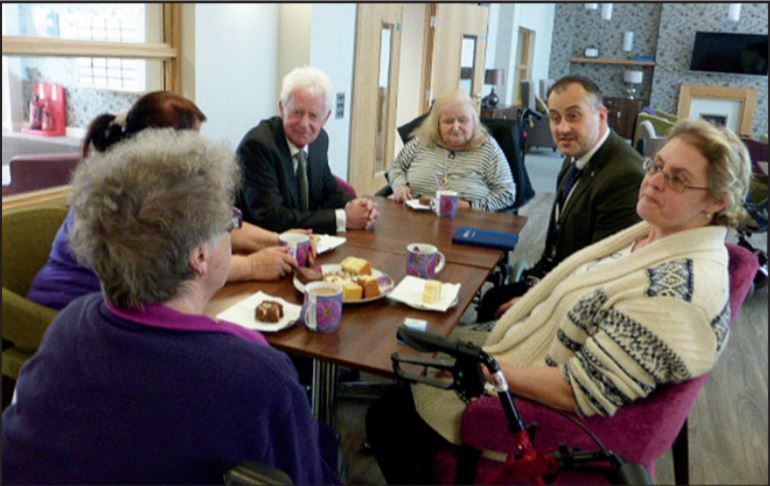 Elderly residents of Collingwood Court discuss social care issues with Peter Latham and Fred Birkett.
